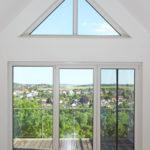 3-Zimmer-Eigentumswohnung Wohnzimmer Fenster mit Balkon